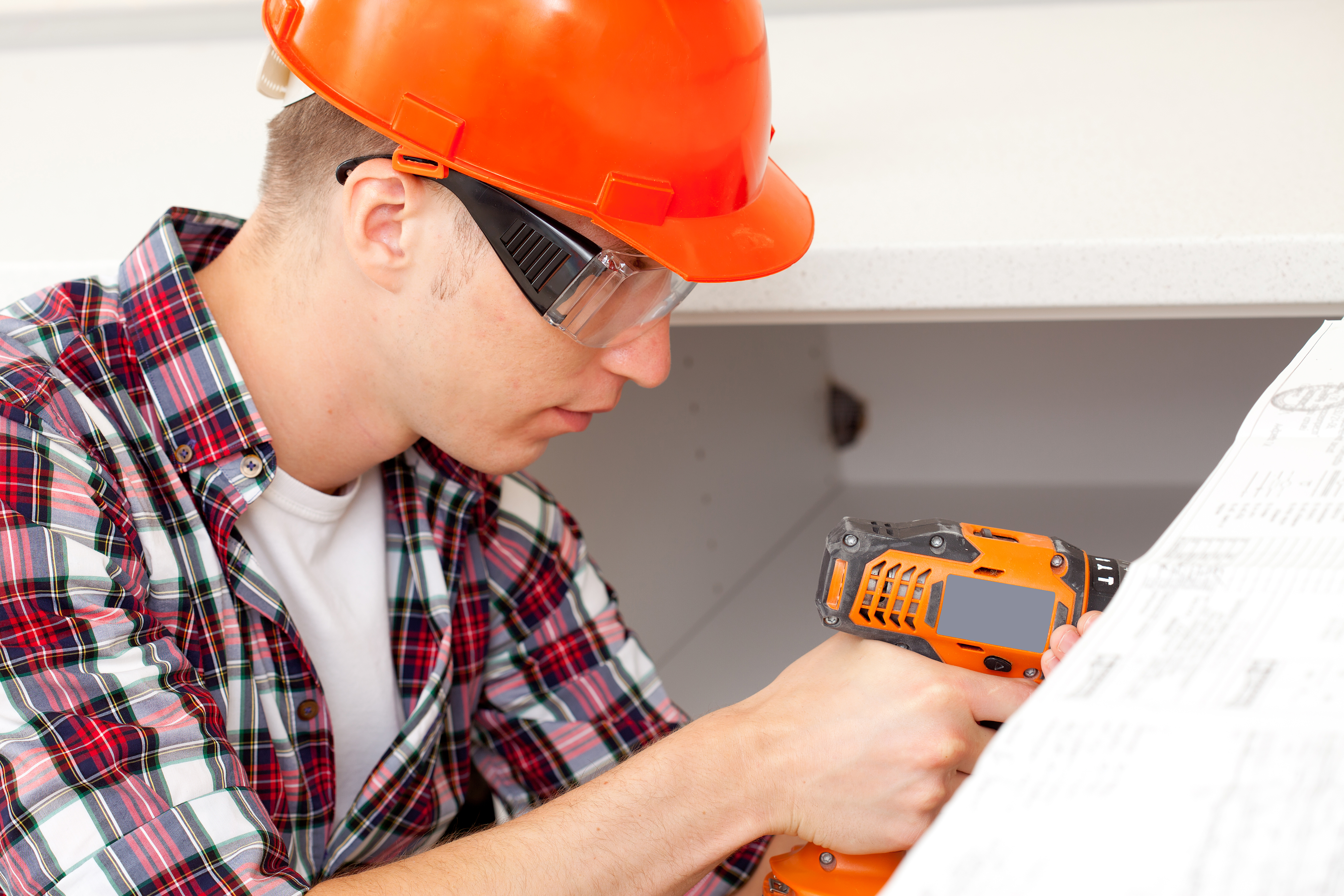 repairman with electric drill